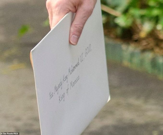 Special delivery! The Duke of Sussex appeared to be carrying a letter from Morocco's King Mohammed VI as he arrived at the monarch's royal residence in Rabat tonight, marking the end of the couple's three-day tour of the north African country