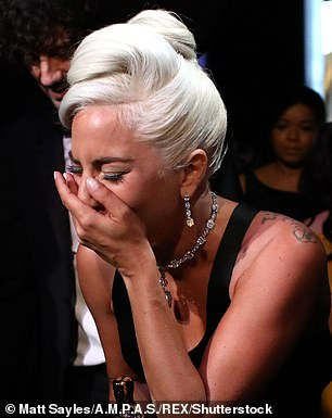 Thrilled: The star was seen sobbing at various points after it was announced that the hit song from A Star Is Born had won the Oscar