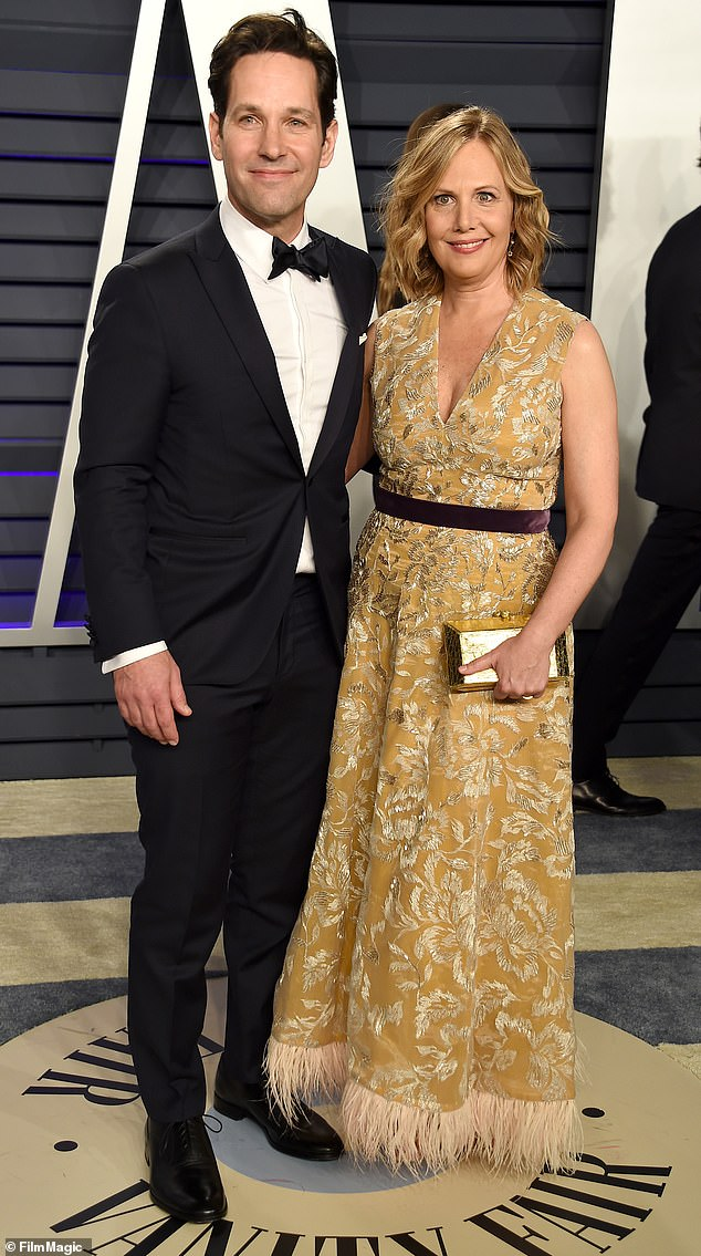 All smiles: The Ant-Man star posed on the red carpet with his wife Julie Yaeger ahead of the awards show