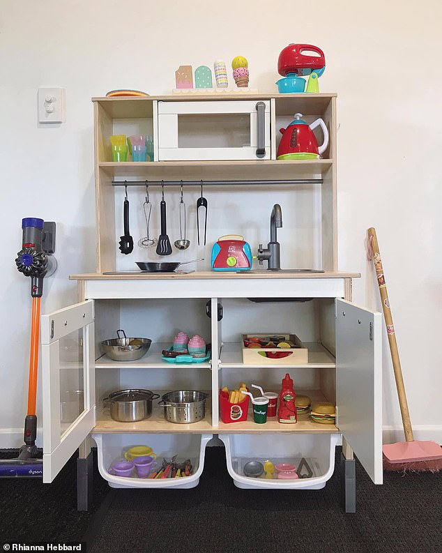 'It is so satisfying for me starting the day with the house clean for the kids,' she said (pictured is the freshly organised toy kitchen space)