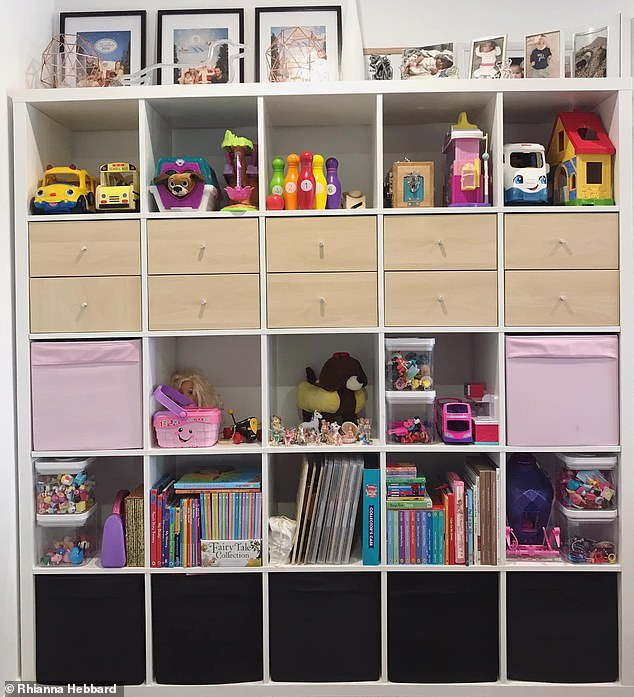 She spent $300 creating this storage space using cubes from IKEA before neatly stacking all of her kids' toys and books inside to make for easy organisation