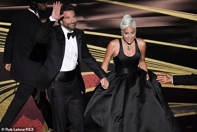 Happy: The pair holding hands after their impassioned performance
