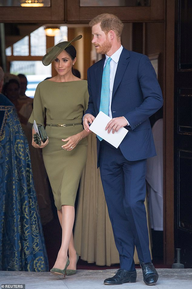 Meghan and Harry exiting the church after the christening of Prince Louis. Meghan stunned in an olive Ralph Lauren number