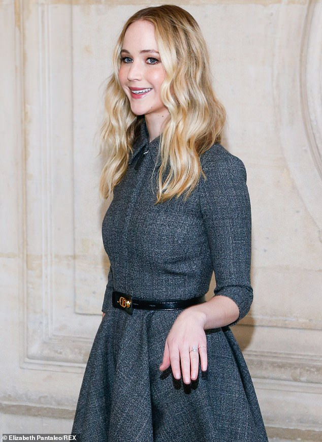 Lucky lady!Jennifer Lawrence proudly displayed her huge ring as she arrived at the Dior autumn-winter Paris Fashion Week presentation at Musée Rodin on Tuesday afternoon