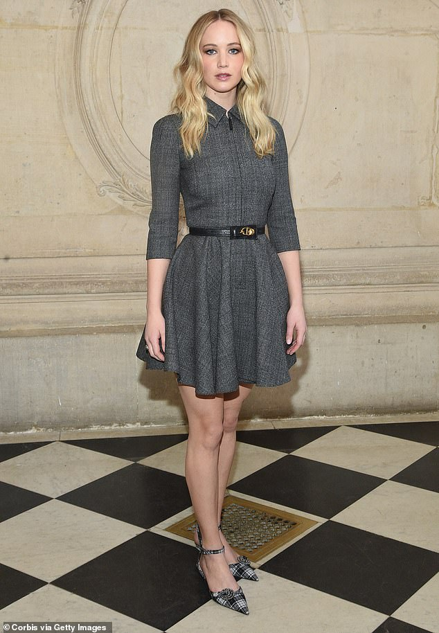 Elegant:The Silver Linings Playbook star looked chic in a charcoal grey tweed collared skater dress, which was belted at the middle to showcase her slim waist