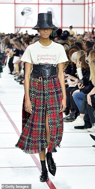 Hat's the way to do it! Leather bucket hats, plaid material, flowing skirts and chunky boots seemed to be a key feature of the Dior presentation