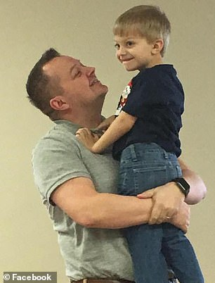 Just a few weeks later, he complained of leg pain and was soon unable to sit up or walk. Pictured: Brysen with his dad, Josh