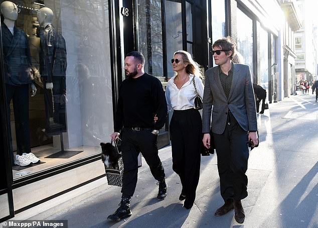 Date:@ The iconic 90s supermodel looked better than ever in a simple and sophisticated ensemble as she pounded the pavements of Paris with her long-term partner