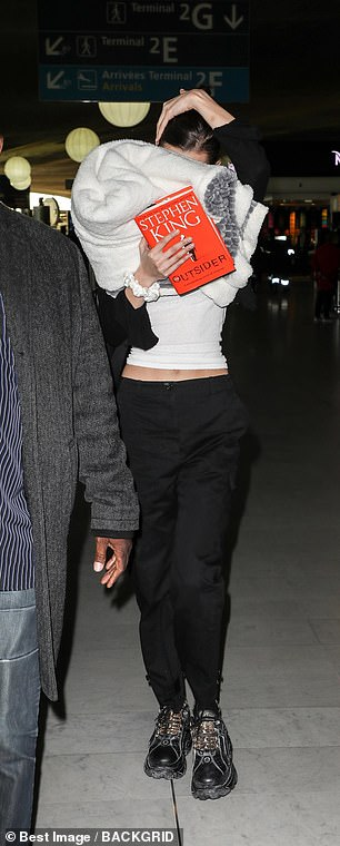 Touching down: Fellow model Bella Hadid was spotted arriving at Charles de Gaulle airport for Fashion Week