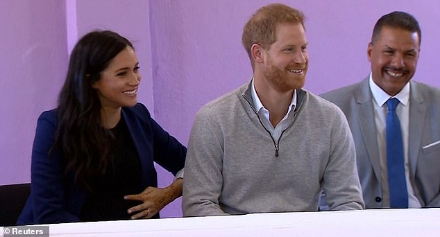 Prince Harry (pictured), 34, couldn't help but show his cheeky side during day two of their official visit toMorocco as he jokingly pretended he was unaware that his wife Meghan - who is due at the end of April - is expecting