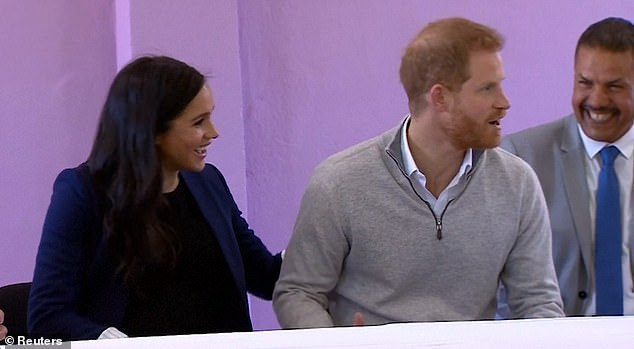 Sitting next to one another, the Duchess' bump visible through her open £395.34 Alice and Olivia tailored long navy blazer, the Duke turned to his wife and pulled a face of mock shock