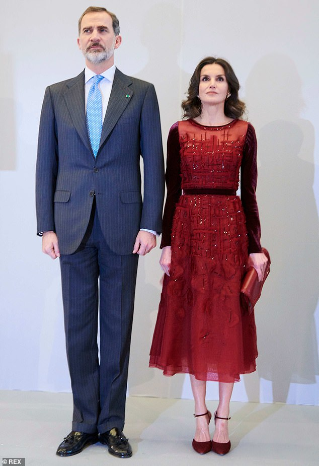 Days before the Duke and Duchess of Sussex's tour, King Felipe and Queen Letizia of Spain paid a visit that was rather more typical of visiting royals. Pictured, the couple pose for photos as theymeet with members of the Spanish community at the National Library in Rabat