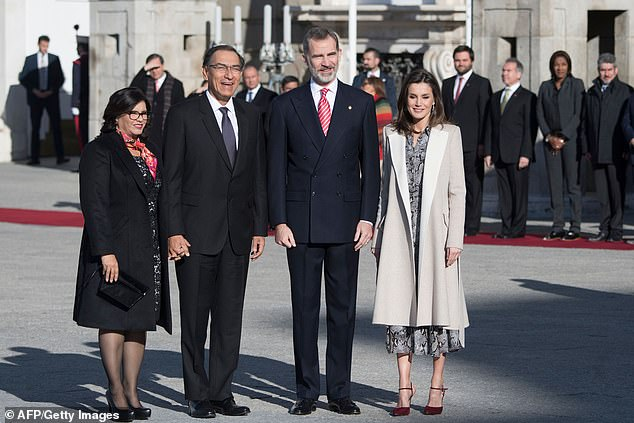 Queen Letizia of Spain (far right) stunned in a snakeskin print dressas she joined her husband King Felipe (second right) to welcome President Martín Vizcarra of Peru (second left) and his wife Maribel Diaz (far left)