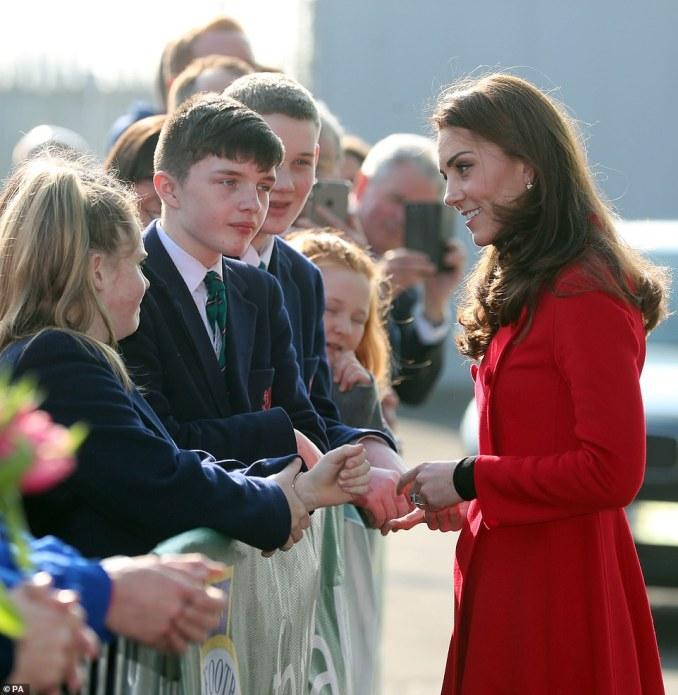 On arrival at the National Stadium at Windsor Park, the couple were greeted by scores of cheering schoolchildren