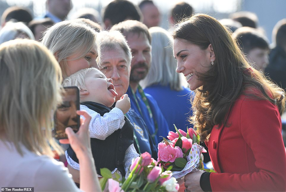 The Duke and Duchess of Sussex have arrived in Belfast for a surprise two-day visit to Northern Ireland. One adorable young well-wisher cheekily stuck out his tongue when the Duchess of Cambridge came over to meet him outside Windsor Park