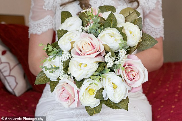Katie didn't want to splash out on flowers that wouldn't last - so she bought artificial ones, including her bouquet, which she ordered on Facebook (pictured)