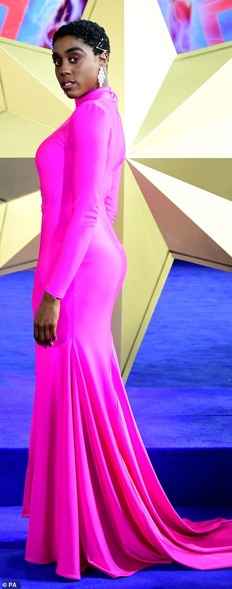 Standing tall: Adding to the racy element of the gown was its soaring thigh-high split which showcased her lean legs to perfection