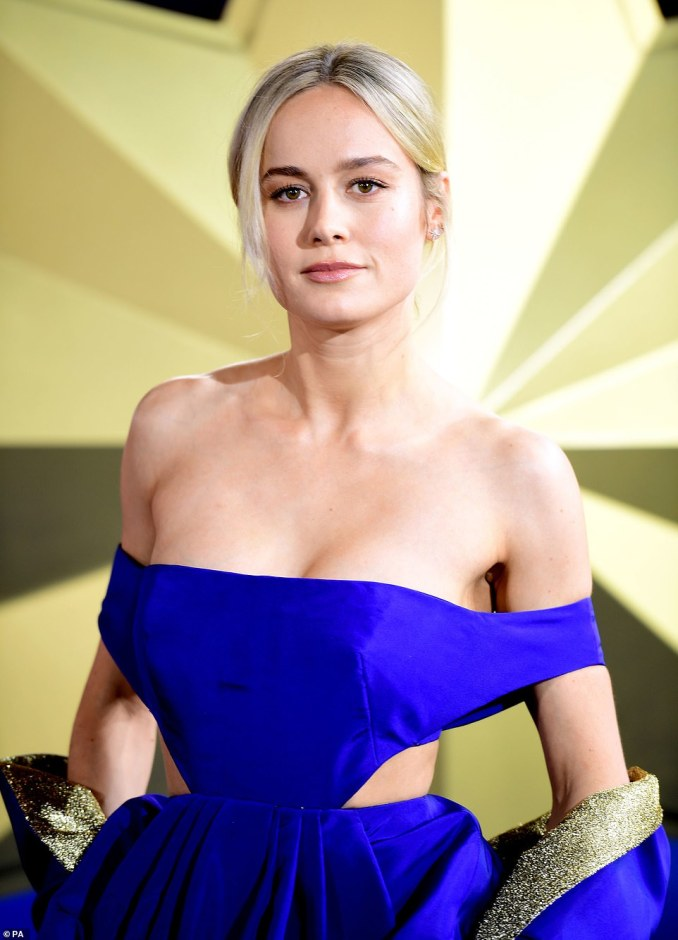 The Oscar winner relied on her naturally striking features with a simple slick of blush-infused make-up, and styled her blonde locks in a casual centre-parted bun which had a few loose tendrils framing her face
