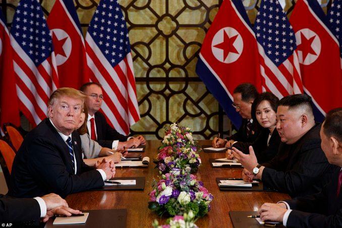 Trump listens as he meets North Korean leader Kim Jong Un on Thursday in Hanoi