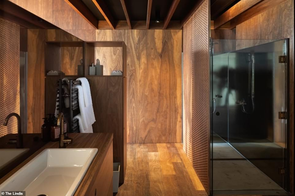 An interior shot of one of the bathrooms, complete with a shower and mirrored wash basin area