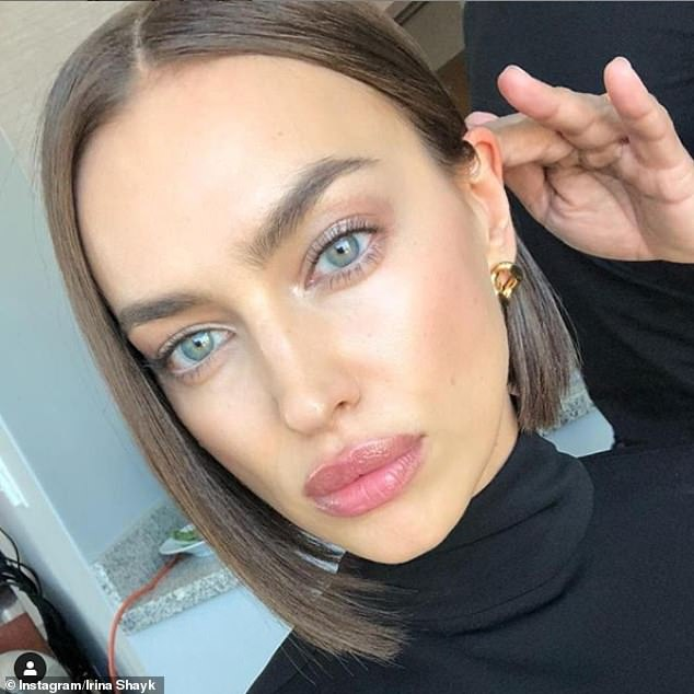 Sombre:Irina Shayk posed a solemn selfie just hours after Lady Gaga denied claims she was having an affair with Bradley Cooper ignited by their steamy Oscars performance