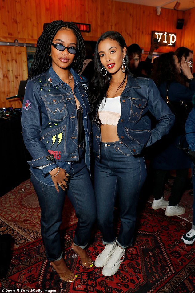 Pals: Maya posed alongside rapper and singer IAMDDB who also went for a double denim look in a jacket with multi-coloured prints