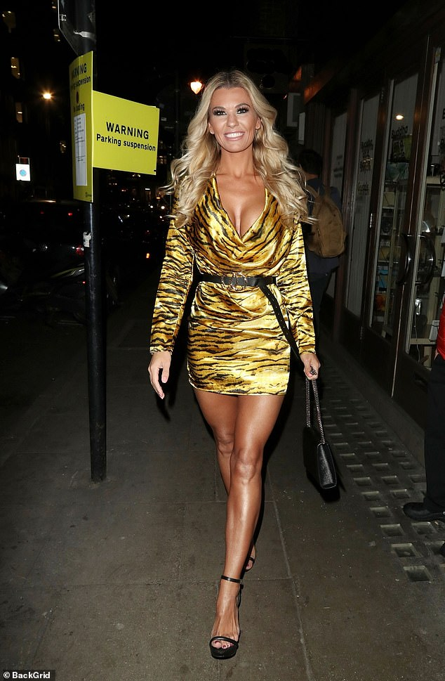 Before: The night before Christine appeared a-ok as she partied in London, stepping out in  an eye-catching frock