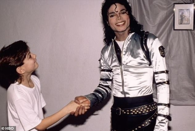 Controversial: A screenshot from Leaving Neverland showing Jackson shaking hands with a young James Safechuck who says he was abused by the singer