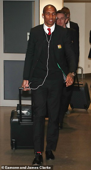 Ashley Young walking through arrivals