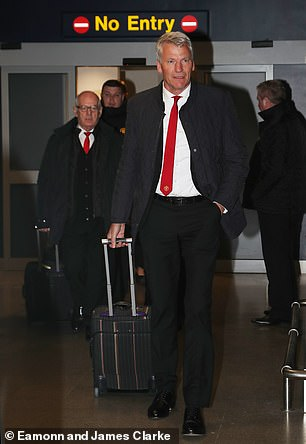 Former United chief David Gill at the airport