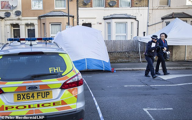 Police at the scene of the Leyton stabbing today as the victim was named locally as Carlos Rodriguez