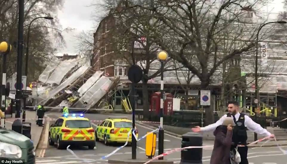 The footage shows emergency services ushering members of the public away from the scaffolding. There are not thought to be any injuries, but the nearby Royal Free Hospital is on standby