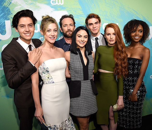 Devastated: Riverdale filming was suspended this week as the cast dealt with the news of Luke's death. Pictured is the cast together with Luke in May 2016