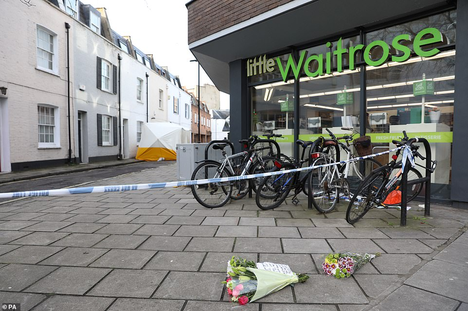 A Little Waitrose store is located just behind the police cordon, where a forensic tent remained in place today