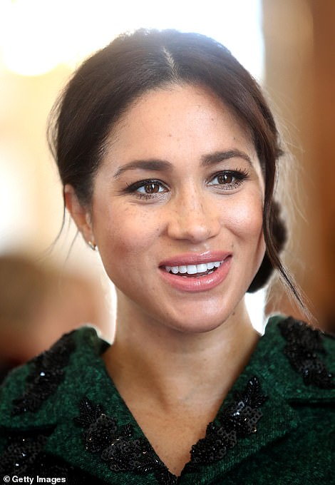 The Duchess of Sussex appears in good spirits as she meets dignitaries at Canada House