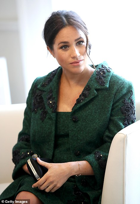 Meghan during this morning's Commonwealth meeting at Canada House