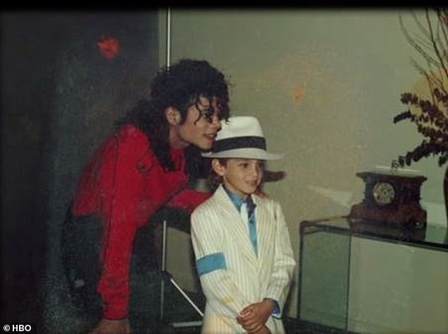 Controversial figure: Despite the claims in Leaving Neverland, Jackson was cleared of all child abuse charges in 2005. Pictured with accuser Wade Robson as a child
