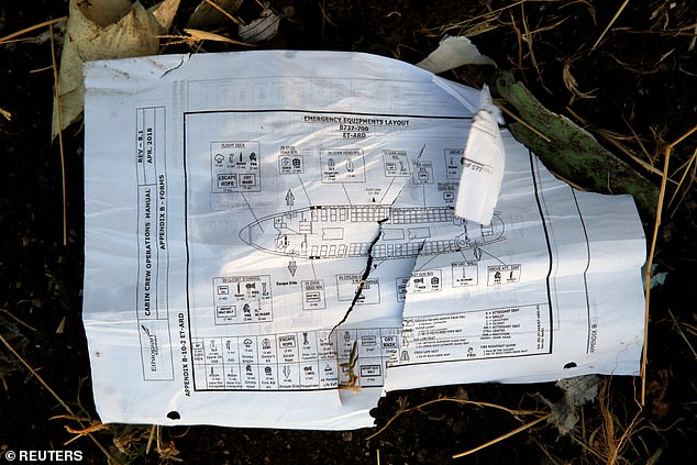 A page of a flight crew operations manual is seen at the scene of the Ethiopian Airlines Flight plane crash today