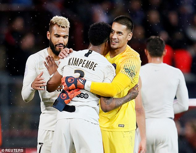 Players congratulated each other afterEric MaximChoupo-Moting (left) made it 4-0 late on