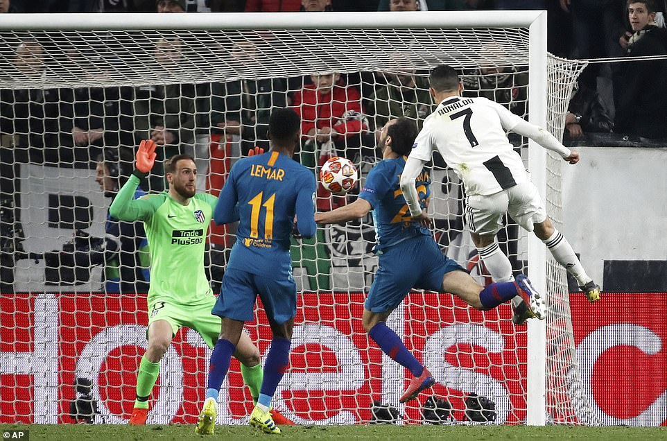 Cristiano Ronaldo towers over Diego Godin in the air to score the opening goal of the night for Juventus before the half-hour