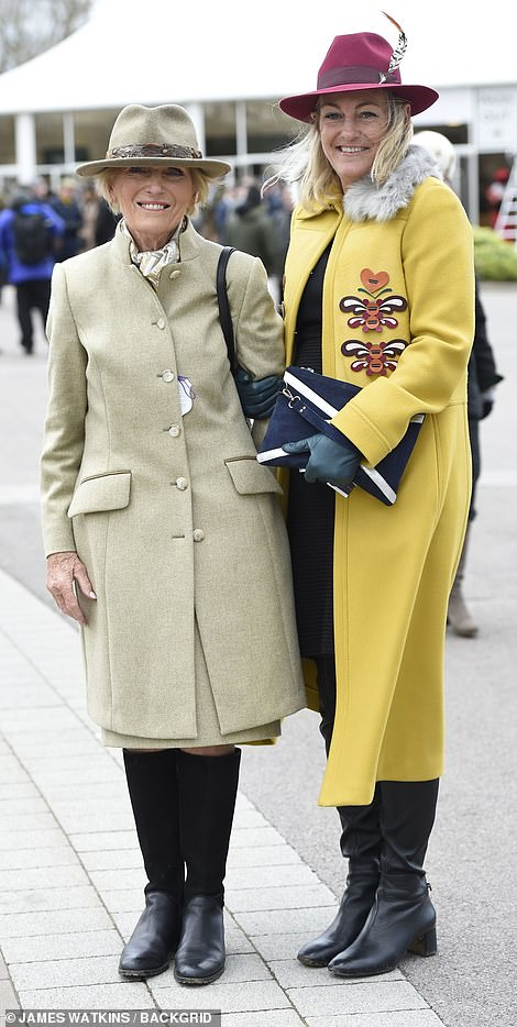 Mary Berry was joined by her daughter Annabel Hunnings, who plumped for a bright yellow wool coat and red trilby to brighten up her all-black outfit
