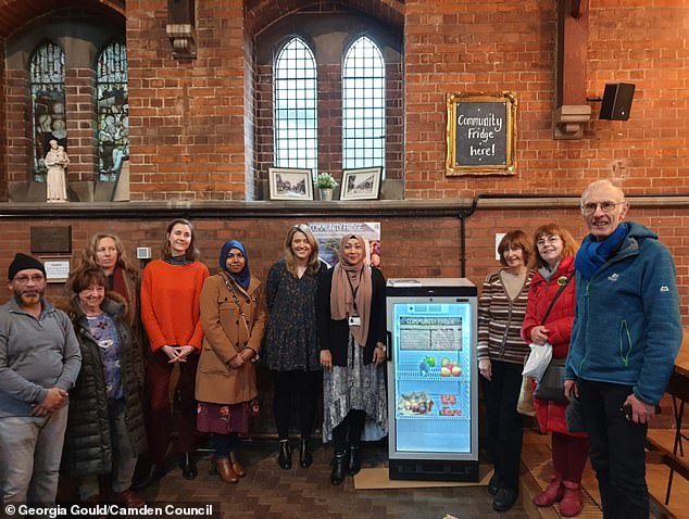 Local council officials, councillors and residents gather for theopening of the community fridge on Tuesday at The Sherriff Centre in West Hampstead, North West London