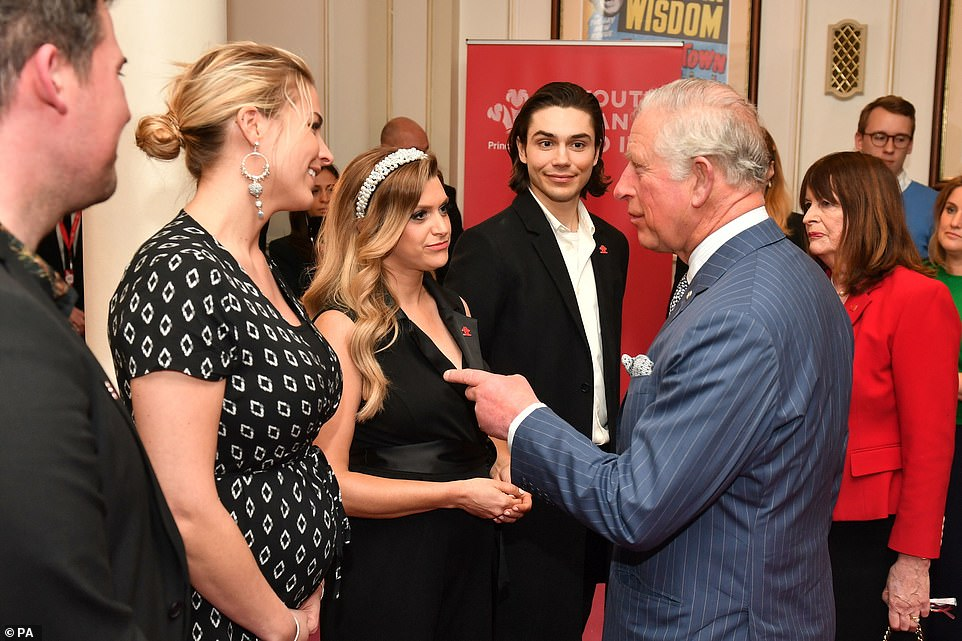 Meeting: Gemma, Anna and George smiled as they listened to one of Prince Charles' anecdotes