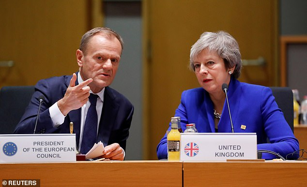 EU Council President Donald Tusk (seen with Theresa May in Brussels on November 25) has said he will seek to persuade his colleagues to be 'open' about a long extension to Article 50