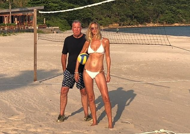 Glowing: Jeremy shared another snap of himself and bikini-clad is on holiday with girlfriend Lisa Hogan, 46