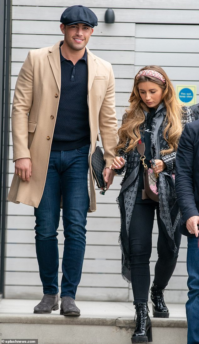Stylish: The Love Island star, 23, appeared in high spirits as she enjoyed the festivities with the Dyer clan, dressed in a monochrome tweed jacket and black skinny jeans