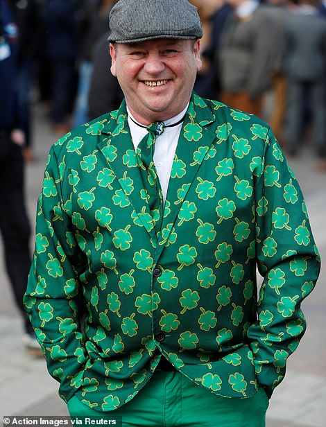 This jolly reveller arrived in an emerald green suit with a jacket and tie emblazoned with four-leaf clovers