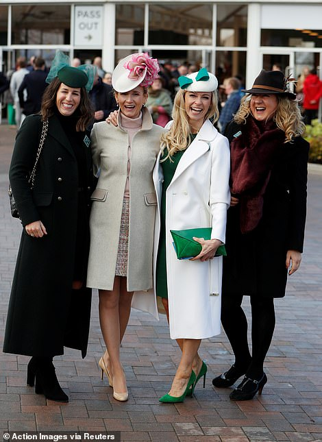 Many ladies went for bold, block colours and structured beret-style hats with feather and bow embellishments
