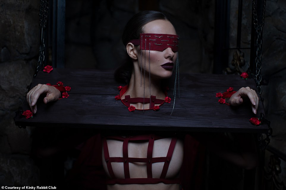 Exclusive images from recent Kinky Rabbit Club parties shows that at one of them, a woman with a red blindfold was shackled to a piece of wood