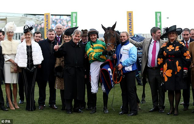 Sire Du Berlais ridden by Barry Geraghty and winning connections following their victory